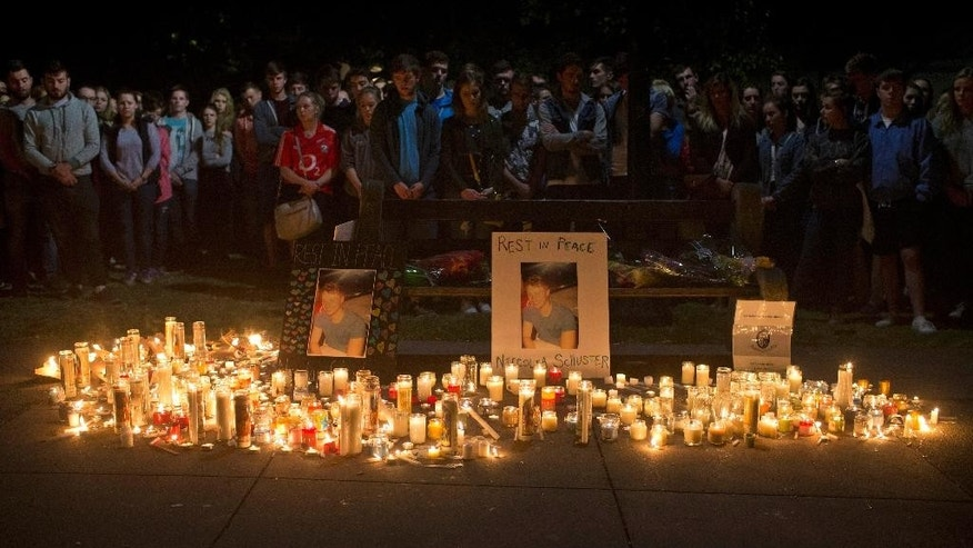 Mourners stand by during a candlelight vigil for six Irish students Wednesday, June 17, 2015, in Berkeley, Calif. The six Irish students died when a balcony collapsed during a party.  (AP Photo/Beck Diefenbach)