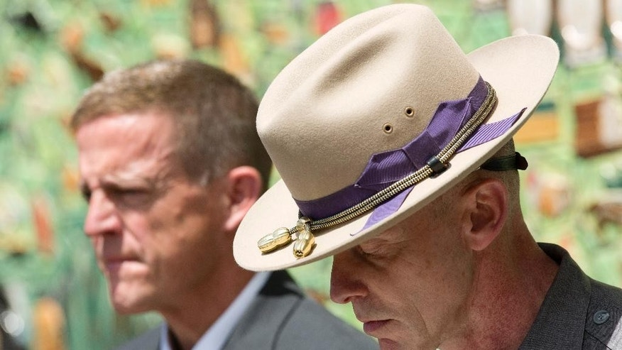 Maj. Charles Guess, right, with the New York State Police and Clinton County District Attorney Andrew Wylie listen to a question at a news conference, Wednesday, June 17, 2015, in Plattsburgh, N.Y. where they discussed the escape of David Sweat and Richard Matt from the Clinton Correctional Facility in Dannemora, N.Y. The pair escaped from the maximum-security facility 12 days ago. (AP Photo/Mark Lennihan)