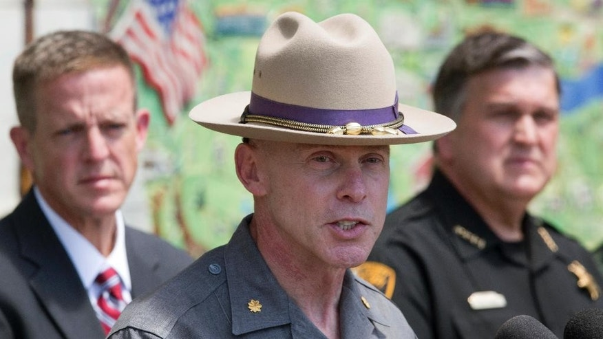 Maj. Charles Guess, center, with the New York State Police, Clinton County District Attorney Andrew Wylie, left, and Clinton County Sheriff David Favro attend a news conference, Wednesday, June 17, 2015, in Plattsburgh, N.Y. where they discussed the escape of David Sweat and Richard Matt from the Clinton Correctional Facility in Dannemora, N.Y.  The pair escaped from the maximum-security facility 12 days ago. (AP Photo/Mark Lennihan)