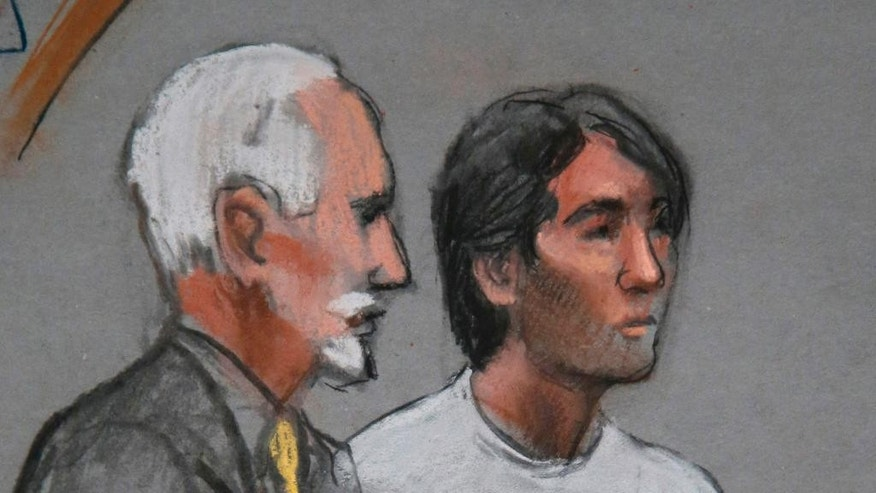 FILE - In this May 30, 2014, file courtroom sketch, Khairullozhon Matanov, right, stands with attorney Paul Glickman in federal court in Boston, facing obstruction of justice charges in the investigation of the Boston Marathon bombings. Matanov who had dinner with the Boston Marathon bombers hours after the 2013 attack was sentenced Thursday, June 18, 2015, to 2½ years in prison for misleading investigators by failing to disclose his contact with the brothers in the days after the bombings and deleting files from his computer. (AP Photo/Jane Flavell Collins, File)