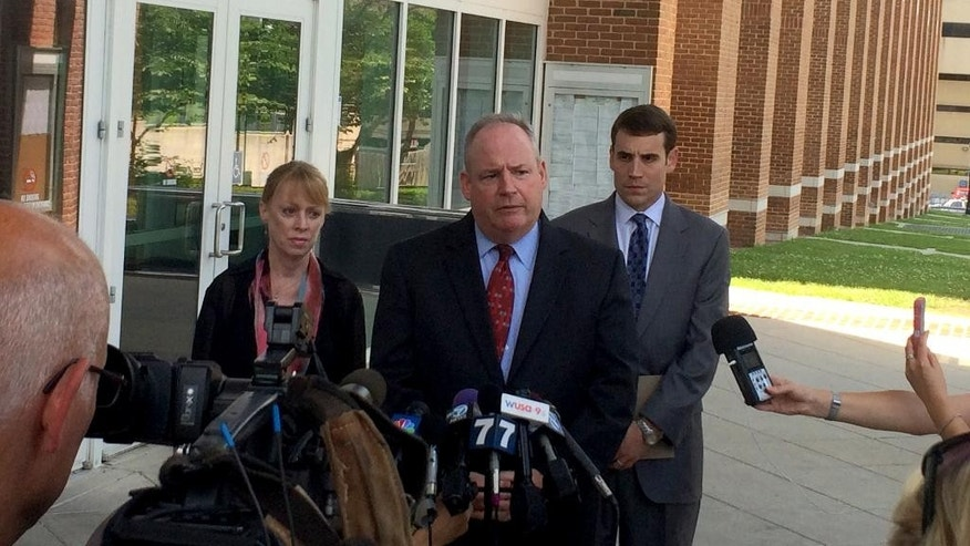 Fairfax County, Va., Commonwealth's Attorney Ray Morrogh, center, talks to reporters in Fairfax, Va., Thursday, June 18, 2015, after a hearing in which the victim of a 2005 sexual assault gave victim-pact testimony that will be used at the sentencing of Jesse Matthew, 33, of Charlottesville, Va. Matthew is charged in an unrelated case with the abduction and killing of University of Virginia student Hannah Graham. Morrogh is joined by Gil Harrington, mother of slain student Morgan Harrington, whose case has been linked by DNA evidence to the 2005 attack in Fairfax, left, and Chief Deputy Commonwealth's Attorney Casey Lingan. (AP Photo/Matt Barakat)