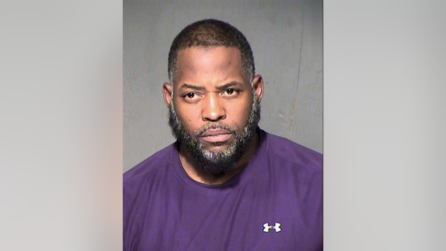 FILE - This undated law enforcement booking photo from the Maricopa County, Ariz., Sheriff's Department shows Abdul Malik Abdul Kareem. As federal prosecutors in Phoenix investigate whether more people might be involved, the case against 43-year-old Abdul Malik Abdul Kareem provides a window into how Kareem, Elton Simpson and Nadir Soofi planned to attack major events, including the cartoon contest where Simpson and Soofi were killed by police May 3.(Maricopa County Sheriff's Department via AP, File)