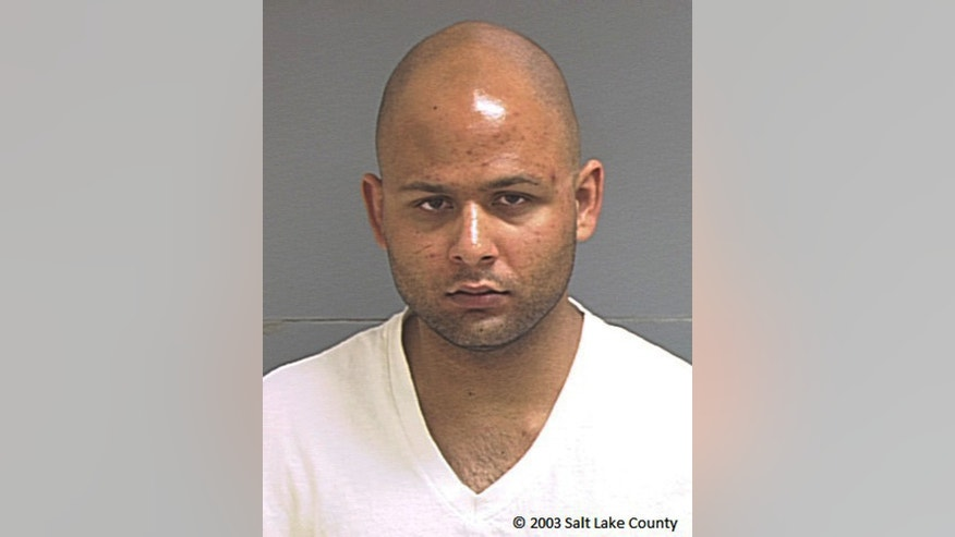 FILE - This April 2003 photo provided by the Salt Lake County Sheriff's Office shows Nadir Soofi. As federal prosecutors in Phoenix investigate whether more people might be involved, the case against 43-year-old Abdul Malik Abdul Kareem provides a window into how Kareem, Elton Simpson and Nadir Soofi planned to attack major events, including the cartoon contest where Simpson and Soofi were killed by police May 3. (Salt Lake County Sheriff's Office via AP, File)