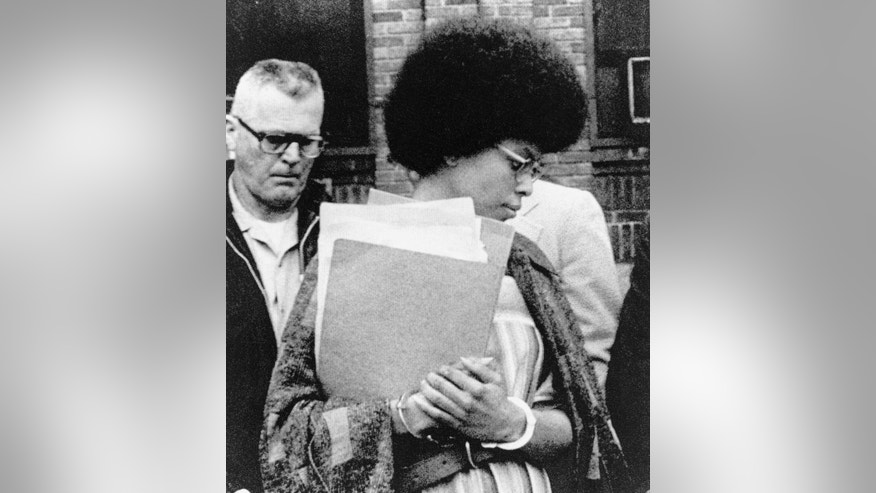 FILE - In this April 25, 1977, file photo, Joanne Chesimard, member of the Black Panther Party and Black Liberation Army, leaves Middlesex County courthouse in New Brunswick, N.J. Chesimard was granted asylum in Cuba after her 1979 escape from the New Jersey prison where the former Black Panther was serving a life sentence in the killing of a New Jersey state trooper. She remains there to this day. (AP Photo, File)