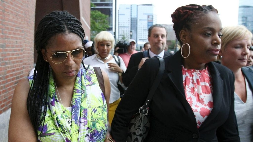 Supporters of David Wright leave federal court after a hearing Friday, June 19, 2015, in Boston where Wright and Nicholas Rovinski pleaded not guilty on charges of conspiring to provide material support to a terrorist organization by plotting with Boston terror suspect Usaamah Rahim to behead conservative blogger Pamela Geller. The plot was not carried out.  (AP Photo/Bill Sikes)
