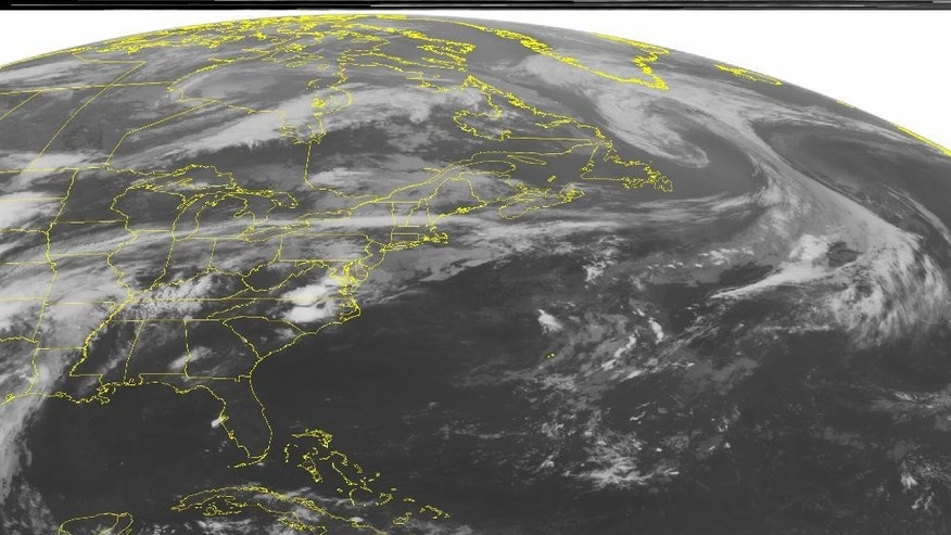 This NOAA satellite image taken Thursday, June 18, 2015, at 12:45 AM EDT shows a large cluster of thunderstorms developing over the Mid-Atlantic and North Carolina along a stationary frontal boundary that has stalled out along the Appalachian Mountains. Tropical Depression Bill is progressing further inland as is covers the Southern Plains with moderate to heavy rains embedded with thunderstorm cells. More severe thunderstorms are firing up ahead of a cold front over the Northern Plains. (Weather Underground via AP)
