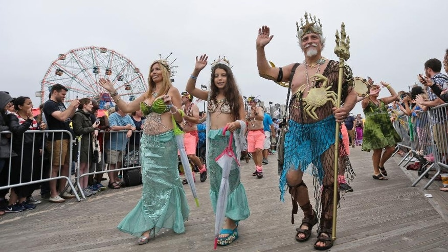 Participants march on the boardwalk during the 33rd annual Mermaid Parade, Saturday, June 20, 2015, in Coney Island in the Brooklyn borough of New York. (AP Photo/Mary Altaffer)