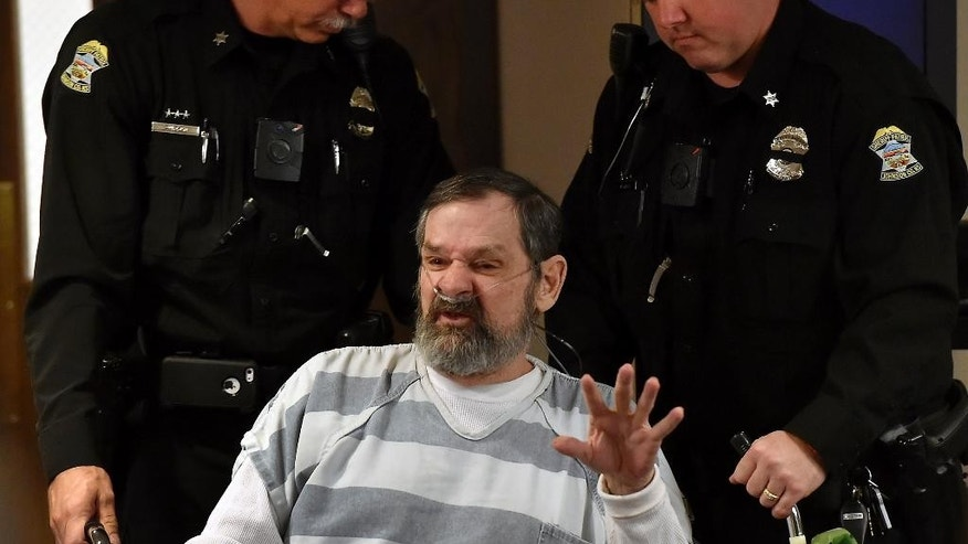 April 2014: In this file photo, Frazier Glenn Miller Jr.,accused of killing three people at two Jewish sites in suburban Kansas City, is wheeled out of a Johnson County, Kan., courtroom.