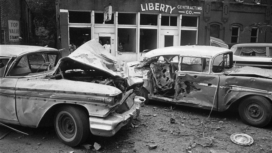 FILE - In this Sept. 15, 1963 file photo, damaged automobiles show the force generated by an explosion which tore large pieces of stone from the 16th Street Baptist Church during services in Birmingham, Ala. A bomb planted by Ku Klux Klansmen ripped apart the building and killed four black girls. (AP Photo)