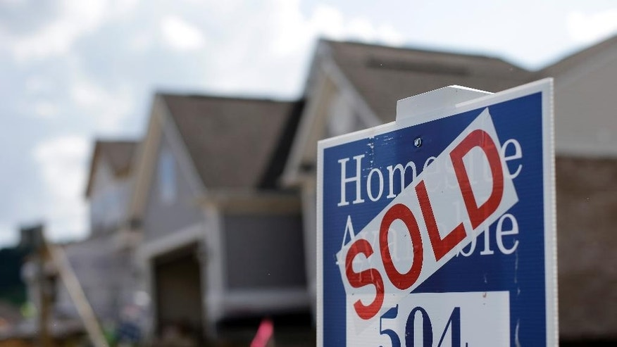 This June 4, 2015 photo, shows a sold sign at a new home development under construction in Nashville, Tenn. The Commerce Department releases new home sales for May on Tuesday, June 23, 2015. (AP Photo/Mark Humphrey)