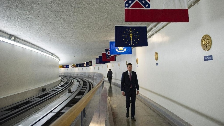 The Mississippi flag hangs, with the other 49 state flags, in the subway between the U.S. Capitol and Dirksen Senate Office Building in Washington, Tuesday, June 23, 2015. In the wake of a massacre at a black church in Charleston, S.C., a bipartisan mix of officials across the country is calling for the removal of Confederate flags and other symbols of the Confederacy. Leaders of the Republican-controlled state are divided on whether to alter the Mississippi flag, a corner of which is made up of the Confederate battle flag. (AP Photo/Cliff Owen)