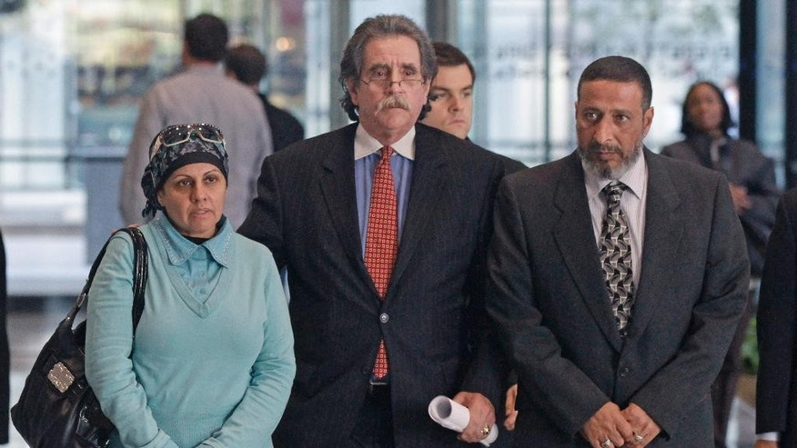 Attorney Thomas Durkin, center, leads his client Adel Daoud's parents, Mona, left, and Ahmed, through the federal courthouse lobby in Chicago.