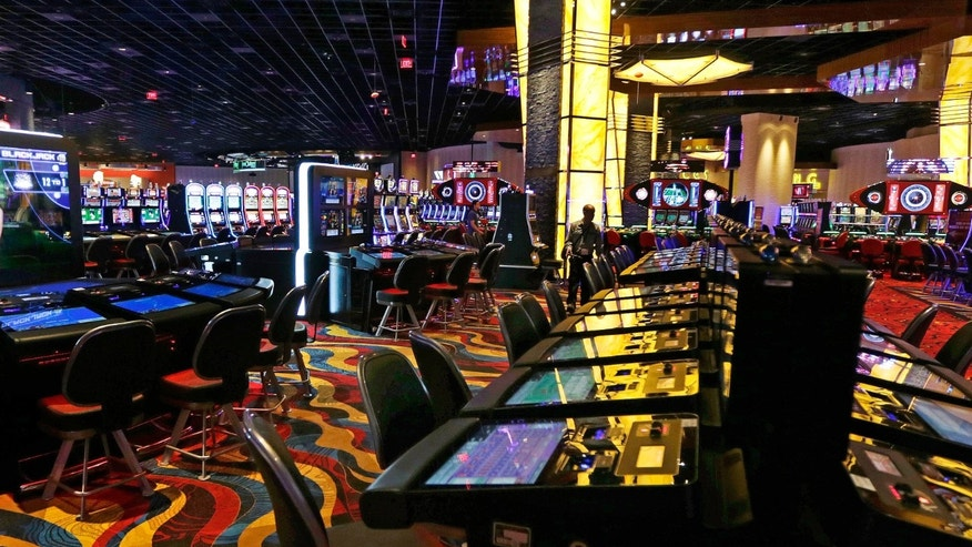 Slot machine lights glow on the floor of the Plainridge Park Casino in Plainville, Mass., Tuesday, June 23, 2015. The casino, a slot machine parlor, is scheduled to open on Wednesday June, 24, 2015.