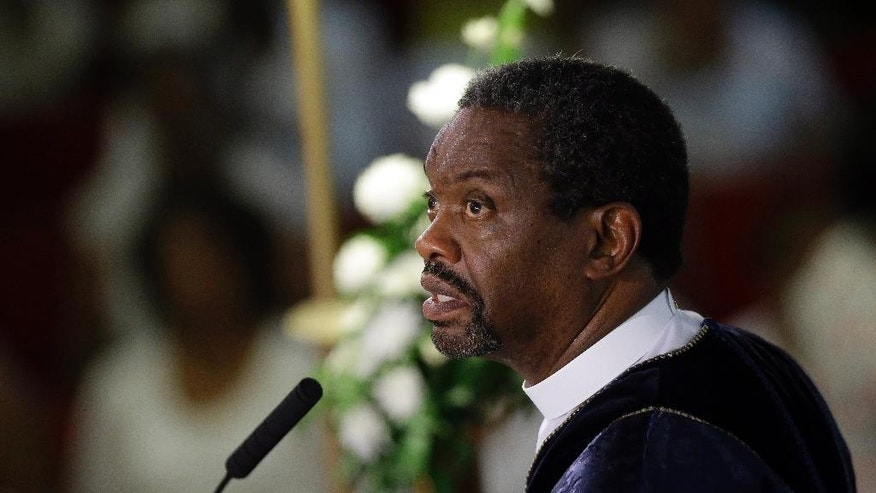 """FILE - In this June 21, 2015, file photo, Rev. Norvel Goff speaks during a prayer service at the Emanuel A.M.E. Church in Charleston, S.C., four days after a mass shooting that claimed the lives of it's pastor and eight others. The 65-year-old Goff was named interim leader of the historic church called """"Mother Emanuel"""" at one of the lowest points in its nearly 200-year history. But the Georgetown, South Carolina, native says the church won't dwell on the past. (AP Photo/David Goldman, Pool, File)"""