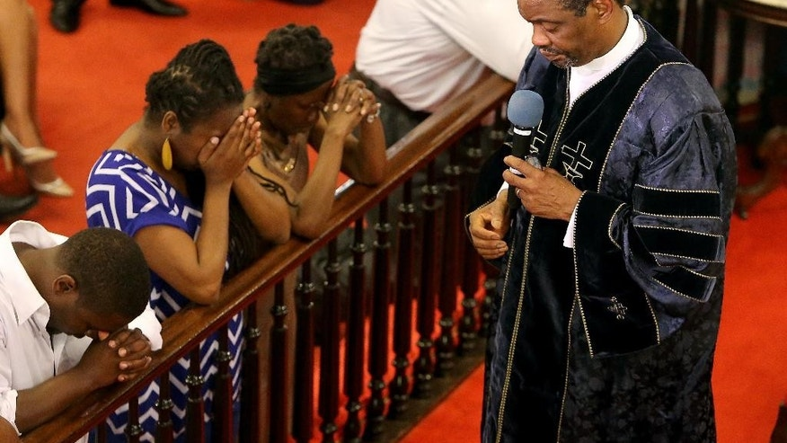 """FILE - In this June 21, 2015, file photo, Rev. Dr. Norvel Goff speaks during a worship service at Emanuel A.M.E. Churchin Charleston, S.C., four days after a mass shooting at the church claimed the lives of its pastor and eight others. The 65-year-old Goff was named interim leader of the historic church called """"Mother Emanuel"""" at one of the lowest points in its nearly 200-year history. But the Georgetown, South Carolina, native says the church won't dwell on the past. (Paul Zoeller/The Post And Courier via AP, File)"""