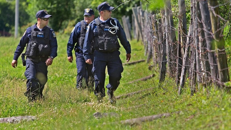 New York State corrections officers search for two escaped prisoners from Clinton Correctional Facility, Wednesday, June 24, 2015, in Malone, N.Y. Hundreds of searchers checked all-terrain vehicle trails and logging roads and went door-to-door in far northern New York trying to close in on David Sweat and Richard Matt, who escaped from the maximum-security prison more than two weeks ago. (Jason Hunter/The Watertown Daily Times via AP)  SYRACUSE OUT MANDATORY CREDIT