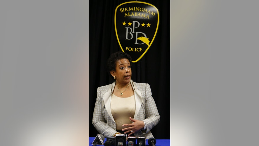 U.S. Attorney General Loretta Lynch speaks with members of the media as she visits the Birmingham Police Academy, Wednesday, June 24, 2015, in Birmingham, Ala. (AP Photo/Hal Yeager)