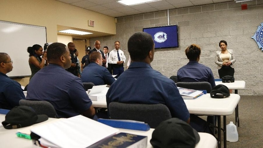 U.S. Attorney General Loretta Lynch speaks with cadets as she visits the Birmingham Police Academy, Wednesday, June 24, 2015, in Birmingham, Ala. (AP Photo/Hal Yeager)