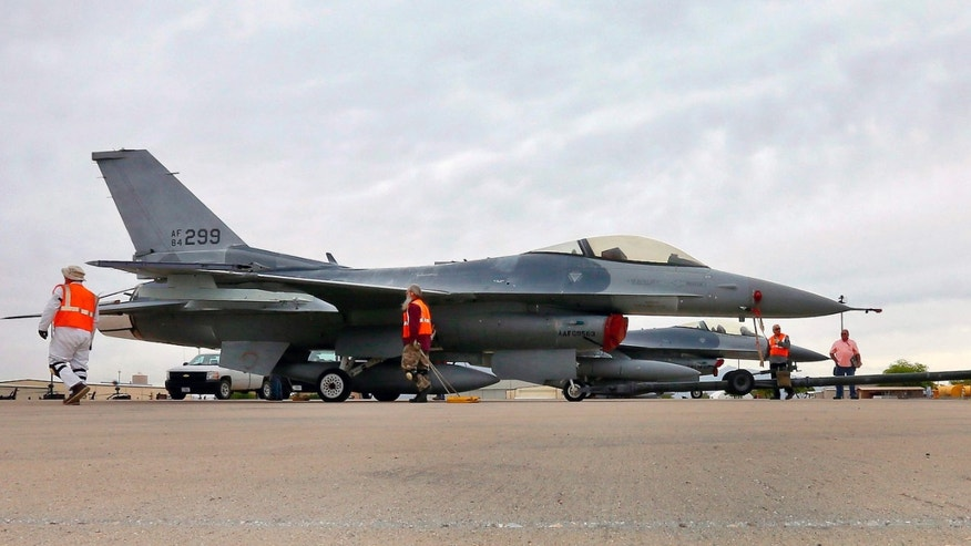 May 15, 2015: A boneyard crew tows an F-16 Fighting Falcon aircraft prior to the preservation process after its arrival at the 309th Aerospace Maintenance and Regeneration Group at Davis-Monthan Air Force Base in Tucson, Ariz.