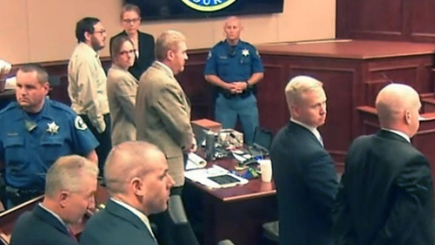 FILE - In this image taken from video on Friday, June 19, 2015,, Colorado movie theater shooter James Holmes, second from left, stands along with defense and prosecution teams, as the jury exits the courtroom for a break in the Holmes trial, in Centennial, Colo. The prosecution, led by District Attorney George Brauchler, second from left, rested its case Friday. Holmes attorneys will open their case  Thursday, June 25, with witnesses they hope can illustrate the severity of his mental illness at the time of the attack. (Colorado Judicial Department via AP, Pool, file)