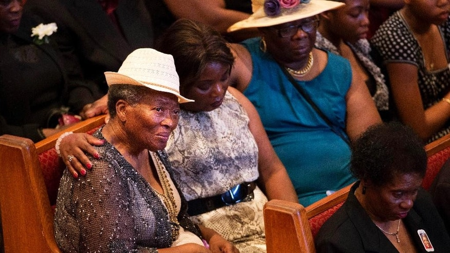Mourners gather before the funeral service for Ethel Lance, one of the nine people killed in the shooting at Emanuel AME Church last week in Charleston, Thursday, June 25, 2015, in North Charleston, S.C. (AP Photo/David Goldman)
