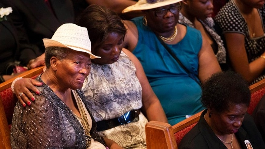 June 25, 2015: Mourners gather before the funeral service for Ethel Lance, one of the nine people killed in the shooting at Emanuel AME Church last week in Charleston, in North Charleston, S.C.