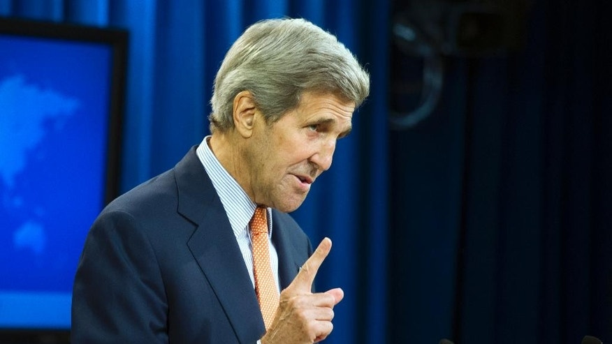 Secretary of State John Kerry speaks to the news media after the State Department released it's annual human rights reports, Thursday, June 25, 2015, at the State Department in Washington. The Obama administration has once again identified Iran and Cuba as serial human rights abusers even as it accelerates attempts to improve relations with both countries. (AP Photo/Cliff Owen)