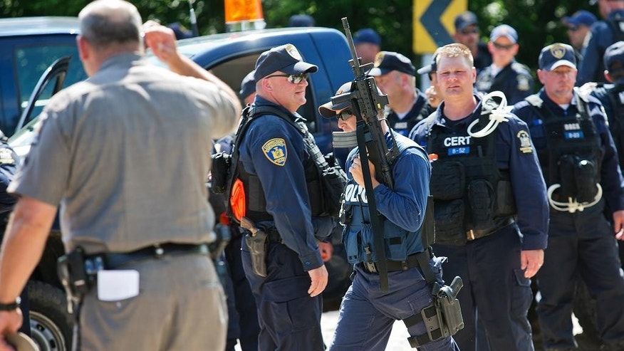 New York State corrections officers gather during a search for two escaped prisoners from Clinton Correctional Facility, Wednesday, June 24, 2015, in Malone, N.Y. Hundreds of searchers checked all-terrain vehicle trails and logging roads and went door-to-door in far northern New York trying to close in on David Sweat and Richard Matt, who escaped from the maximum-security prison more than two weeks ago. (Jason Hunter/The Watertown Daily Times via AP)  SYRACUSE OUT MANDATORY CREDIT