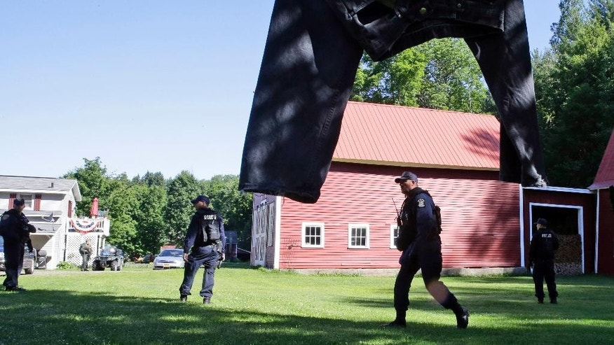 New York State Department of Corrections Officers search an area in Owls Head, N.Y. for convicted murderers Richard Matt and David Sweat, Friday, June 26, 2015. Police shifted a focus of their three week search closer to the Canadian border. (AP Photo/Mary Altaffer)
