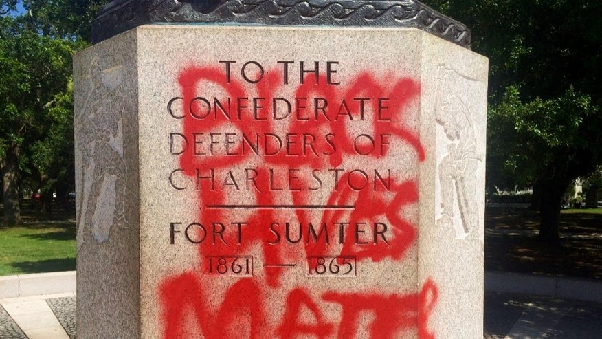 "FILE - This June 21, 2015, file photo shows a statue memorializing the Confederacy spray-painted with the message ""Black Lives Matter"" in Charleston, S.C. Confederate monuments in a half-dozen places this week have been defaced _ a telling sign of the racial tension that permeates post-Ferguson America.  (AP Photo/WCSC-TV, Philip Weiss, File)"
