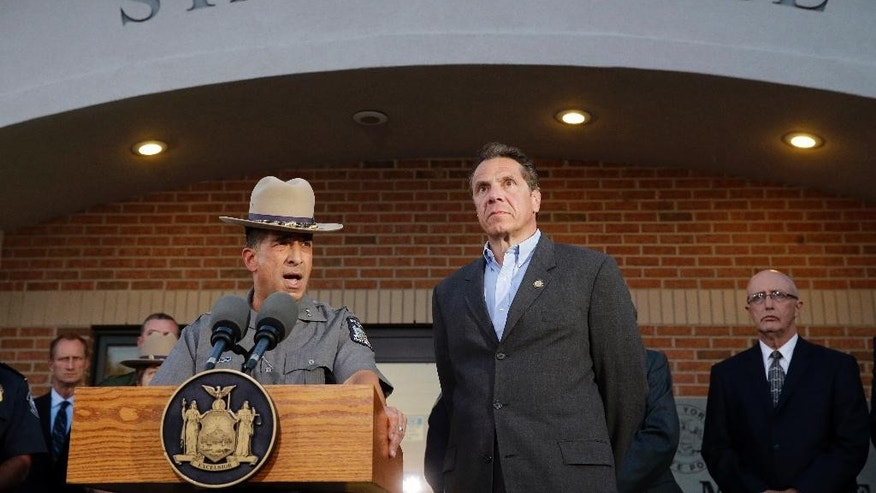 New York State Police Superintendent Joseph D'Amico, left, and Gov. Andrew Cuomo speak to members of the media during a news conference, Friday, June 26, 2015, in Malone, N.Y. Richard Matt, one of two convicted murderers who staged an escape from an upstate maximum-security prison three weeks ago was shot and killed by a Border Patrol agent in a wooded area about 30 miles from the prison on Friday, while David Sweat remains on the run. (AP Photo/Mary Altaffer)