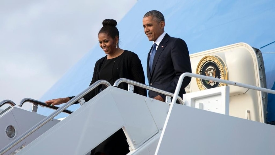 President Barack Obama and first lady Michelle Obama arrive on Air Force One, Friday, June 26, 2015, in Andrews Air Force Base, Md, as they return from Charleston, S.C., where they attended services honoring the life of Rev. Clementa Pinckney at the College of Charleston TD Arena. Pinckney was one of the nine people killed in the shooting at Emanuel AME Church last week in Charleston. (AP Photo/Carolyn Kaster)