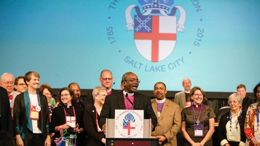 Bishop Michael Curry, of North Carolina, speaks after being elected the Episcopal Church's first African-American presiding bishop at the Episcopal General Convention Saturday, June 27, 2015, in Salt Lake City. Curry won the vote in a landslide. (AP Photo/Rick Bowmer)