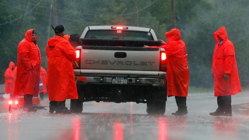 Corrections officers check a vehicle at a roadblock on Sunday, June 28, 2015, in Malone, N.Y. The shooting death of one escaped killer brought new energy to the three-week hunt for a second escaped murderer in the United States as helicopters, search dogs and hundreds of law enforcement officers converged on a wooded area 30 miles from Clinton Correctional Facility. (AP Photo/Mike Groll)