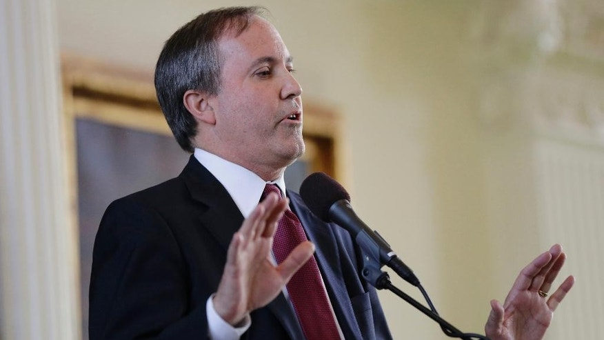 "FILE - In this Jan. 5, 2015, file photio, Ken Paxton speaks after he was sworn in as Texas attorney general in Austin, Texas. Paxton calls the Supreme Court decision giving same-sex couples the right to marry a ""lawless ruling"" and says state workers can cite their religious objections in denying marriage licenses. He warned in a statement Sunday, June 28, 2015, that any clerk, justice of the peace or other administrator who declines to issue a license to a same-sex couple could face litigation or a fine. But in the nonbinding legal opinion, Paxton says ""numerous lawyers"" stand ready to defend, free of charge, any public official refusing to grant one. (AP Photo/Eric Gay, File)"