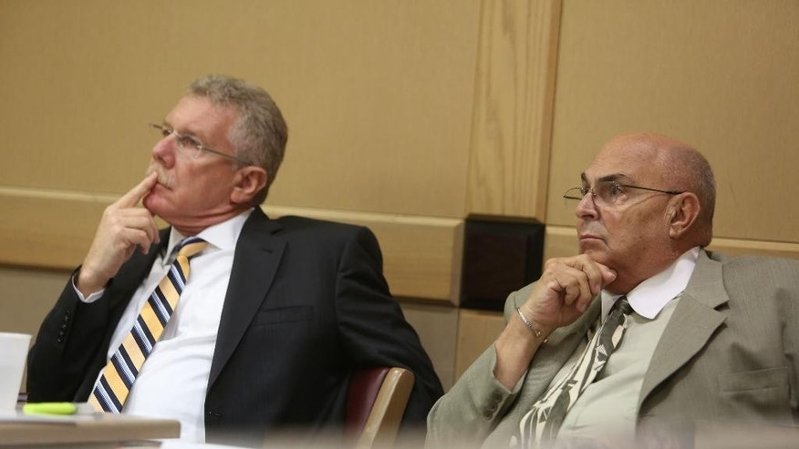 "Defendant Anthony Moscatiello, right, and attorney Sam Halpern listen to closing arguments during Moscatiello's retrial Monday, June 29, 2015 in Fort Lauderdale, Fla. Moscatiello could get the death penalty if convicted for the 2001 shooting death of Konstantinos ""Gus"" Boulis, former SunCruz Casinos chief and founder of Miami Subs restaurants. (Susan Stocker/South Florida Sun-Sentinel via AP, Pool)"