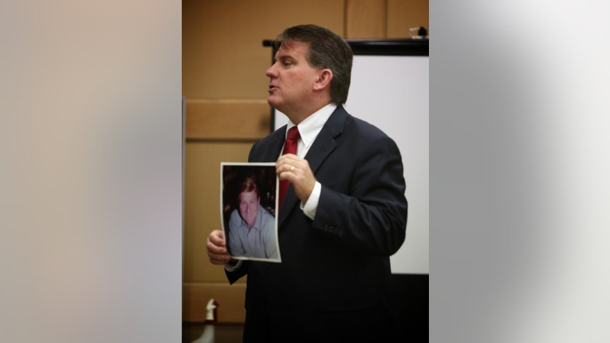 "Prosecutor Gregg Rossman shows the jury a photo of Gus Boulis during closing arguments in the retrial of Anthony Moscatiello, Monday, June 29, 2015 in Fort Lauderdale, Fla. Moscatiello could get the death penalty if convicted for the 2001 shooting death of Konstantinos ""Gus"" Boulis, former SunCruz Casinos chief and founder of Miami Subs restaurants. (Susan Stocker/South Florida Sun-Sentinel via AP, Pool)"