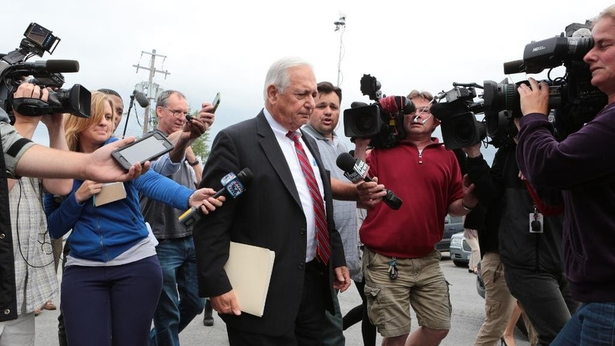 William Dreyer, attorney for Suspended Clinton Correctional Facility corrections officer Gene Palmer, leaves Plattsburgh Town Court after waving waiving his clients' preliminary hearing Monday, June 29, 2015, in Plattsburgh, N.Y. Palmer faces charges of promoting prison contraband, tampering with physical evidence and official misconduct in connection with the escape of convicted killers Richard Matt and David Sweat. (Gabe Dickens/The Press-Republican via AP)