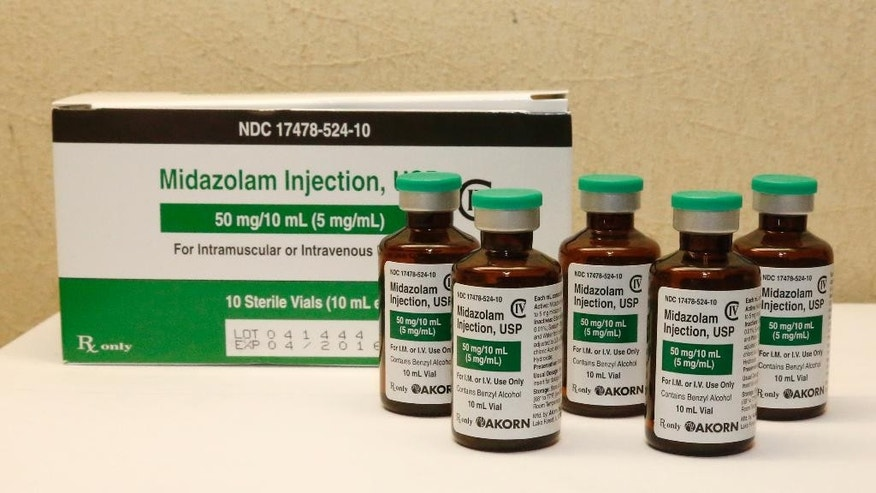 FILE - This Friday, July 25, 2014 file photo shows bottles of midazolam at a hospital pharmacy in Oklahoma City. On Monday, June 29, 2015, The Supreme Court voted 5-4 in a case from Oklahoma saying that the sedative midazolam can be used in executions without violating the Eighth Amendment prohibition on cruel and unusual punishment. (AP Photo/Sue Ogrocki, File)