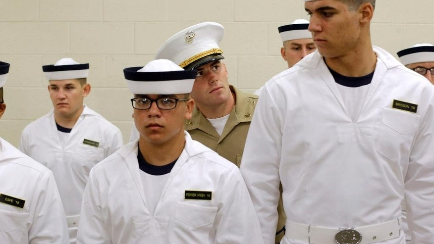 "U.S. Marine Corps second lieutenant Ben Pope, center, inspects prospective plebes as they stand in formation during Induction Day at the U.S. Naval Academy, Wednesday, July 1, 2015, in Annapolis, Md. More than 1,100 young men and women reported for ""I-Day,"" where they received haircuts, medical examinations, new uniforms and instructions on how to salute and address superiors before taking an oath of office to become members of academy's newest class. (AP Photo/Patrick Semansky)"