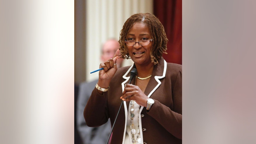 "In this photo taken Friday June 19, 2015, state Sen. Holly Mitchell, D-Los Angeles, speaks before the Senate at the Capitol in Sacramento, Calif.  In January,  black activist Maile Hampton was arrested during a Black Lives Matter protest in Sacramento and charged with felony lynching. The charge for interfering with police during an arrest drew outrage from African-American leaders who noted the irony of the charge. Mitchell's bill to remove the word ""lynching"" from the state penal code is now before Gov. Jerry Brown. (AP Photo/Rich Pedroncelli)"