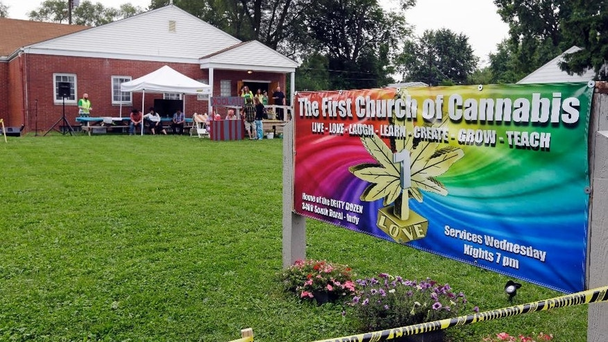 The First Church of Cannabis, established to test Indiana's new religious objections law, will have its first service at noon without marijuana in Indianapolis, Wednesday, July 1, 2015. First Church of Cannabis founder Bill Levin called off plans to light up during the service after local authorities threatened to arrest violators. (AP Photo/Michael Conroy)