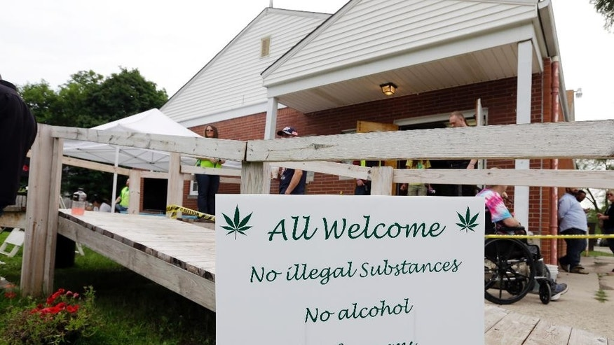 A sign welcomes visitors to First Church of Cannabis for its first service at noon in Indianapolis, Wednesday, July 1, 2015. The first service will be without marijuana. Founder Bill Levin called off plans to light up during the service after local authorities threatened to arrest violators. (AP Photo/Michael Conroy)