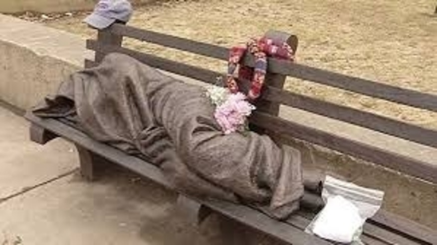 April 3, 2015: An image from video shows a work by Canadian sculptor Timothy Schmalz, a blanket-shrouded Jesus identifiable only by the crucifixion wounds on his feet, outside St. Paul's Episcopal Cathedral in Buffalo, NY.