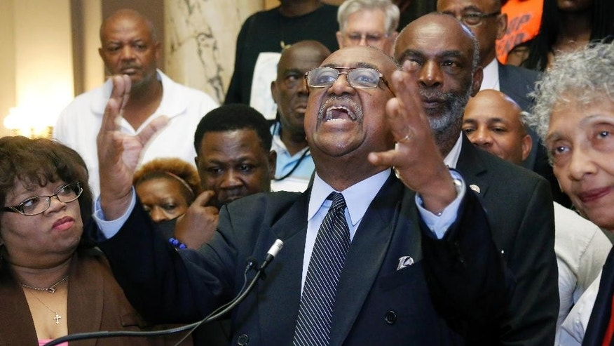 """Charles Steele Jr., national president of the Southern Christian Leadership Conference says Confederate symbols represent """"treason"""" and need to be removed from public spaces, including from the Mississippi state flag, at a news conference at the Capitol in Jackson, Miss., Wednesday, July 1, 2015. Steele says Confederate names should be taken off of schools and public buildings across the South, including the predominantly black Robert E. Lee High School in Montgomery, Alabama. (AP Photo/Rogelio V. Solis)"""