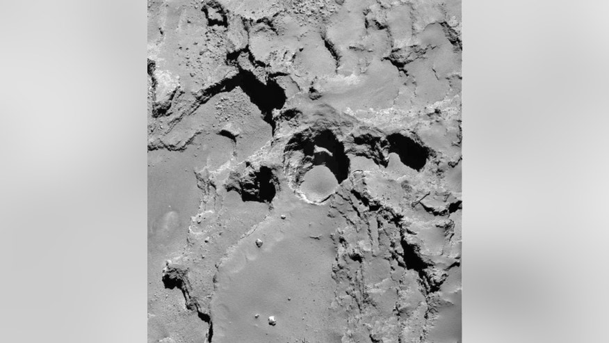 This Dec. 21, 2014 photo made by the European Space Agency's Rosetta spacecraft and provided by researchers led by Jean-Baptiste Vincent shows the most active pit, known as Seth_01, which scientists believe is one of several sinkholes on the comet 67P/Churyumov-Gerasimenko. The new observations and analysis were released Wednesday, July 1, 2015 by the journal Nature. (Vincent et al., Nature Publishing Group, ESA via AP)