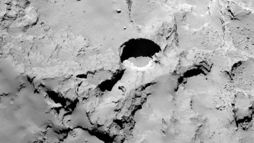 This Dec. 20, 2014 photo made by the European Space Agency's Rosetta spacecraft and provided by researchers led by Jean-Baptiste Vincent shows the most active pit, known as Seth_01, which scientists believe is one of several sinkholes on the comet 67P/Churyumov-Gerasimenko. The new observations and analysis were released Wednesday, July 1, 2015 by the journal Nature. (Vincent et al., Nature Publishing Group, ESA via AP)
