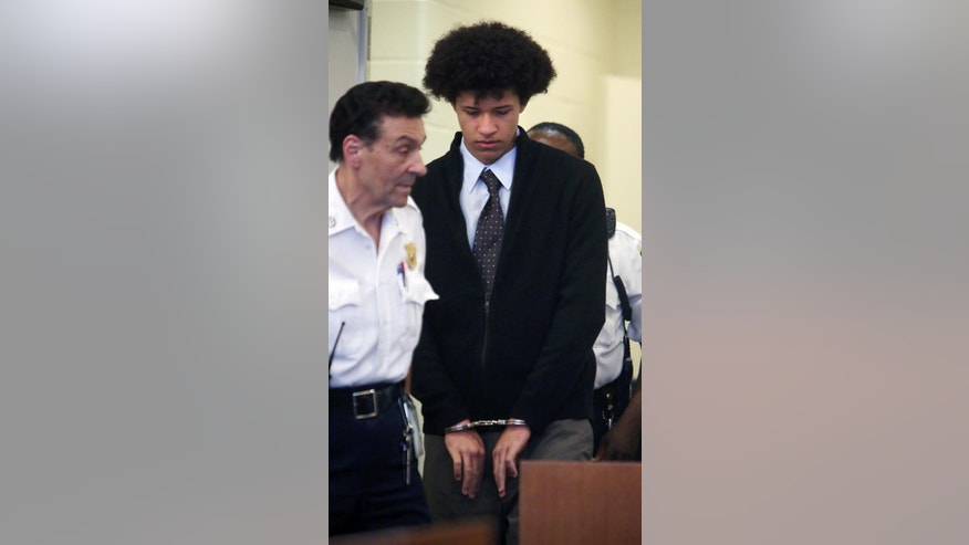 In this photo taken Tuesday, June 30, 2015, Philip Chism is led into Salem Superior Court for a hearing in Salem, Mass. Lawyers for Chism, a Massachusetts teenager charged with killing his high school math teacher, asked a judge on Tuesday to move his trial out of eastern Massachusetts, saying it will be difficult to pick an impartial jury given the large amount of publicity the case has received. (Ken Yuszkus/The Eagle Tribune via AP,  Pool)