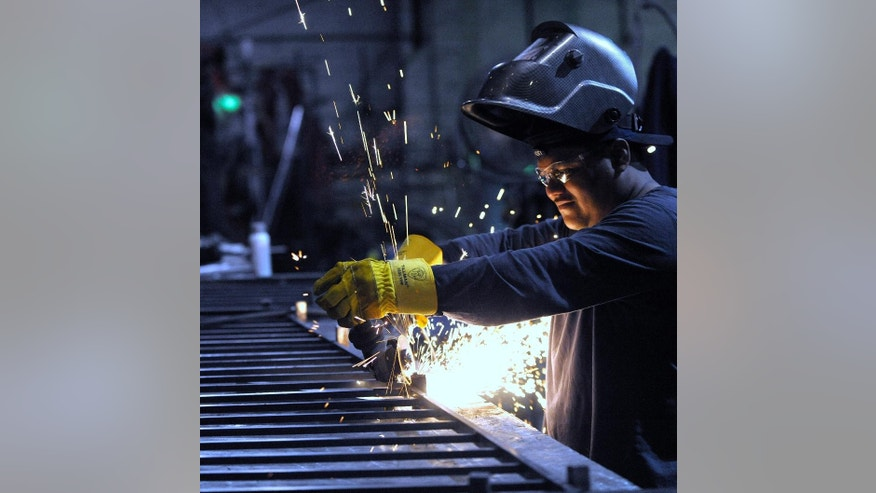 In this photo taken June 11, 2015, machinist Angel Altamirano, 32, of River Rouge, grinds a guardrail for a staircase in Detroit. The Institute for Supply Management, a trade group of purchasing managers, issues its index of manufacturing activity for June on Wednesday, July 1, 2015. (Todd McInturf /The Detroit News via AP) DETROIT FREE PRESS OUT; HUFFINGTON POST OUT