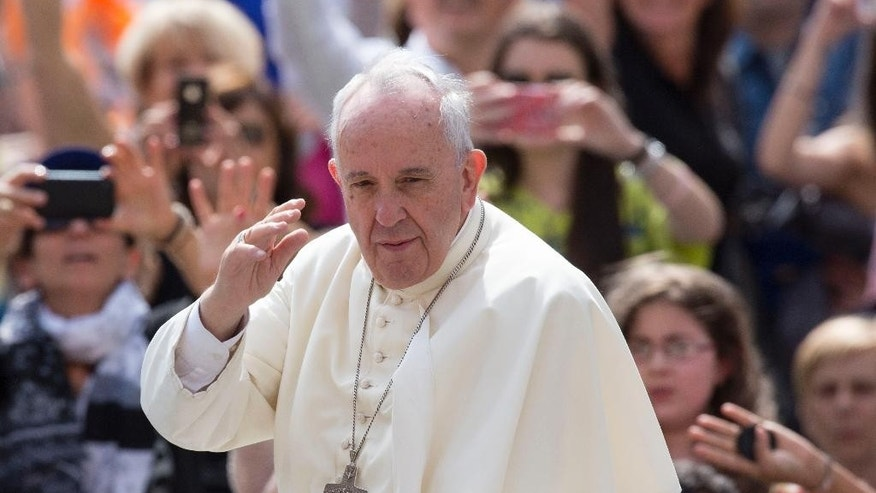 FILE - In this June 24, 2015, file photo, Pope Francis waves to the faithful as he arrives for his weekly general audience, in St. Peter's Square, at the Vatican. Roman Catholic leaders in the early voting state of Iowa will call July 2, on candidates for president to follow the teachings of Pope Francis and focus as much on the environment and income inequality in 2016 as they have in past elections on opposing gay marriage and abortion. (AP Photo/Riccardo De Luca, File)
